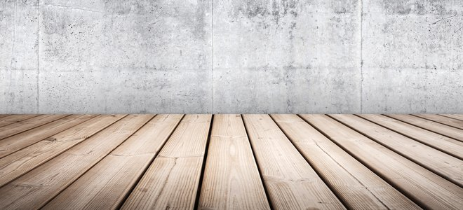 Empty concrete interior background with wooden floor