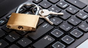 Padlock on a laptop keyboard. Concept of internet security