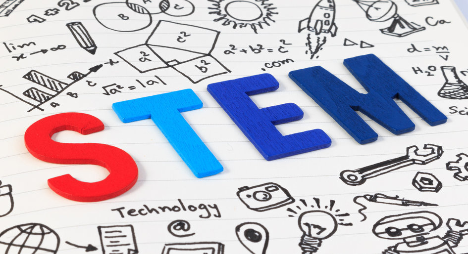 STEM subjects for learning, Science Technology Engineering Mathematics. STEM concept with drawing background. Magnifying glass over education background.